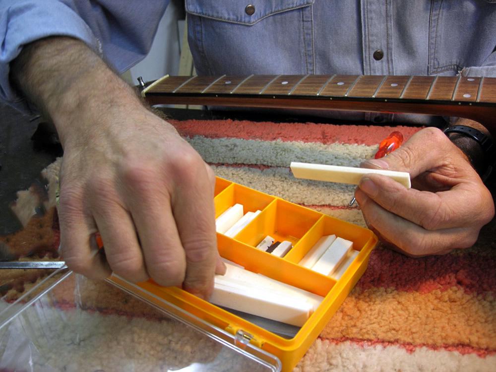 Selecting new materials for custom guitar bridge nut
