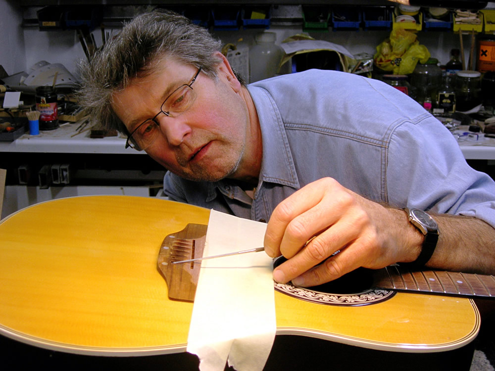 Checking rake angle for guitar string spacing