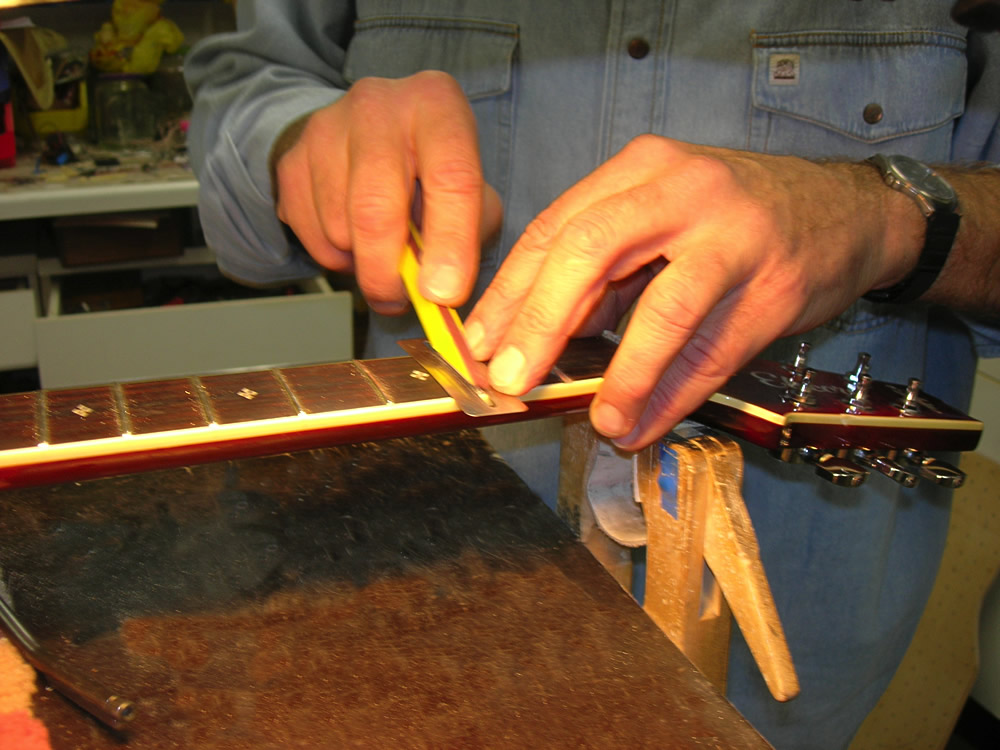 Aria Elecord flatting and polishing the frets